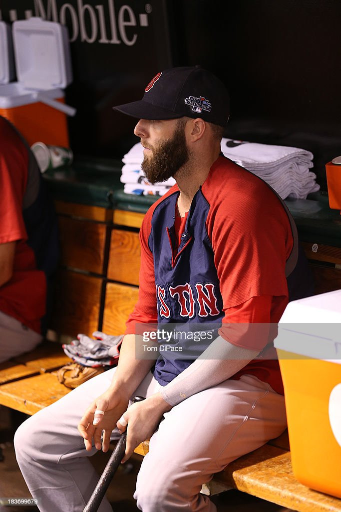 Dustin Pedroia #15 of the Boston Red Sox looks on from the dugout during batting practice before Game 4 of the American League Division Series against the Tampa Bay Rays on Monday, October 8, 2013 at Tropicana Field in St. Petersburg, FL.