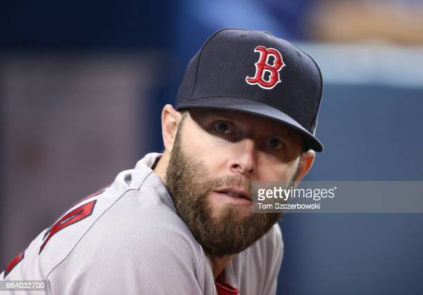 Dustin Pedroia of the Boston Red Sox looks on from the top step of the dugout during MLB game action against the Toronto Blue Jays at Rogers Centre...