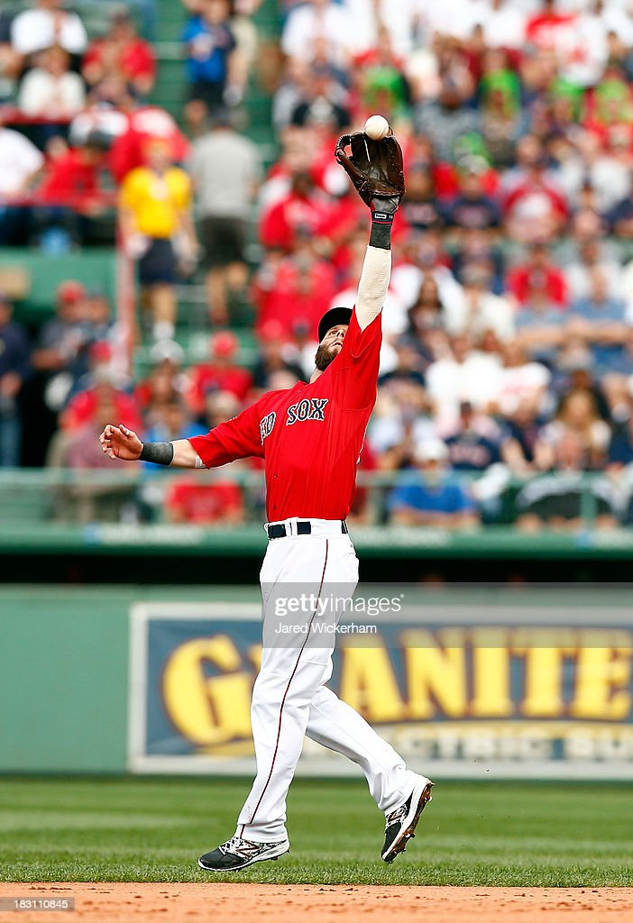 Dustin Pedroia #15 of the Boston Red Sox makes a catch against the Tampa Bay Rays in the second inning during Game One of the American League Division Series at Fenway Park on October 4, 2013 in Boston, Massachusetts.