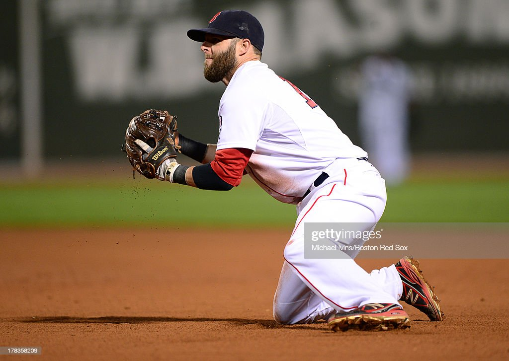 <a gi-track='captionPersonalityLinkClicked' href=/galleries/search?phrase=Dustin+Pedroia&family=editorial&specificpeople=836339 ng-click='$event.stopPropagation()'>Dustin Pedroia</a> #15 of the Boston Red Sox makes a play from his knees against the Baltimore Orioles during the eighth inning on August 29, 2013 at Fenway Park in Boston, Massachusetts.