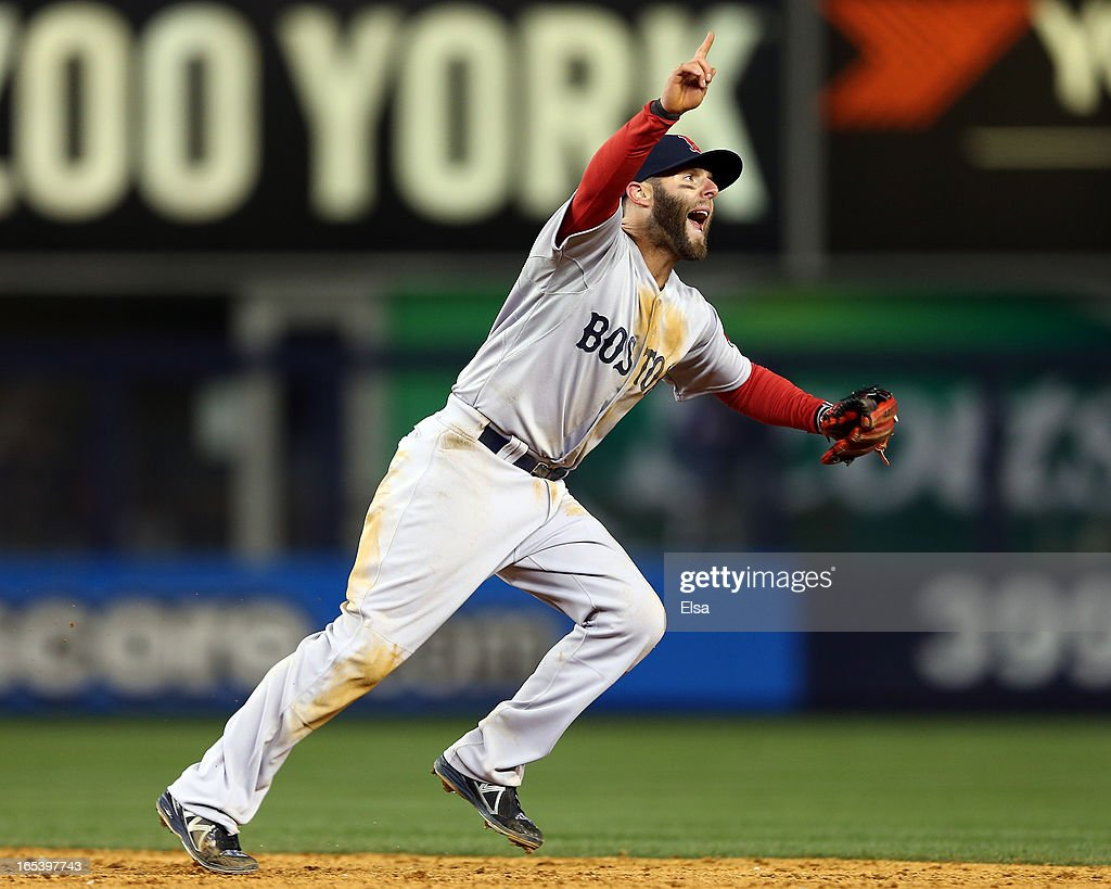 <a gi-track='captionPersonalityLinkClicked' href=/galleries/search?phrase=Dustin+Pedroia&family=editorial&specificpeople=836339 ng-click='$event.stopPropagation()'>Dustin Pedroia</a> #15 of the Boston Red Sox points to the final out of the game against the New York Yankees as teammate Shane Victorino makes the catch on April 3, 2013 at Yankee Stadium in the Bronx borough of New York City.The Boston Red Sox defeated the New York Yankees 7-4.