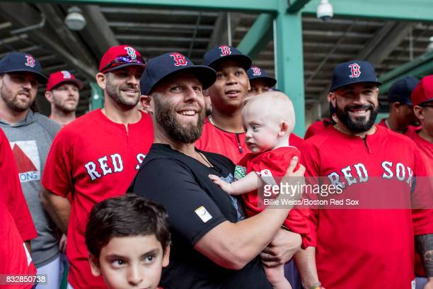 Dustin Pedroia of the Boston Red Sox poses with a Jimmy Fund patient during the 2017 WEEINESN Jimmy Fund RadioTelethon before a game against the St...