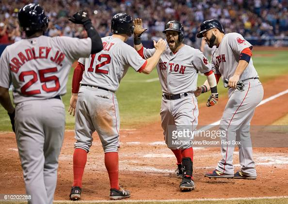 Dustin Pedroia of the Boston Red Sox reacts after a grand slam against the Tampa Bay Rays in the seventh inning on September 24 2016 at Tropicana...