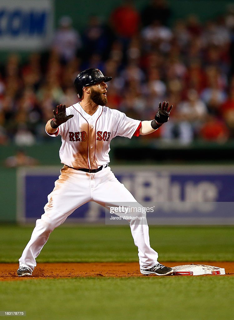Dustin Pedroia #15 of the Boston Red Sox reacts after being tagged out between first and second base by the Tampa Bay Rays during Game Two of the American League Division Series at Fenway Park on October 5, 2013 in Boston, Massachusetts.