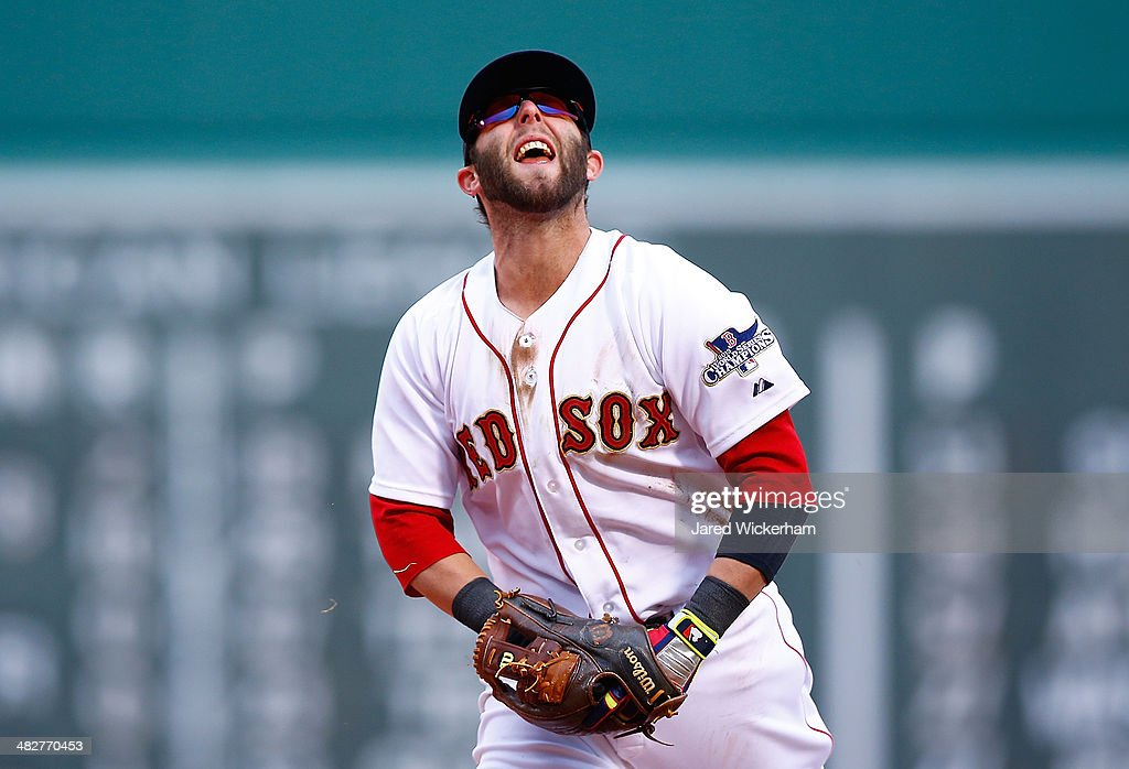 <a gi-track='captionPersonalityLinkClicked' href=/galleries/search?phrase=Dustin+Pedroia&family=editorial&specificpeople=836339 ng-click='$event.stopPropagation()'>Dustin Pedroia</a> #15 of the Boston Red Sox reacts after failing to throw out a member of the Milwaukee Brewers out at first base during the Opening Day game at Fenway Park on April 4, 2014 in Boston, Massachusetts.