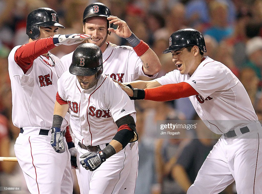 <a gi-track='captionPersonalityLinkClicked' href=/galleries/search?phrase=Dustin+Pedroia&family=editorial&specificpeople=836339 ng-click='$event.stopPropagation()'>Dustin Pedroia</a> #15 of the Boston Red Sox reacts after he hit a three-run home run with teammates <a gi-track='captionPersonalityLinkClicked' href=/galleries/search?phrase=Jarrod+Saltalamacchia&family=editorial&specificpeople=836404 ng-click='$event.stopPropagation()'>Jarrod Saltalamacchia</a> #39 of the Boston Red Sox and <a gi-track='captionPersonalityLinkClicked' href=/galleries/search?phrase=Jacoby+Ellsbury&family=editorial&specificpeople=4172583 ng-click='$event.stopPropagation()'>Jacoby Ellsbury</a> #2 of the Boston Red Sox, who were on base, and Adrian Gonzalez #28 of the Boston Red Sox in the sixth inning at Fenway Park September 13, 2011 in Boston, Massachusetts.