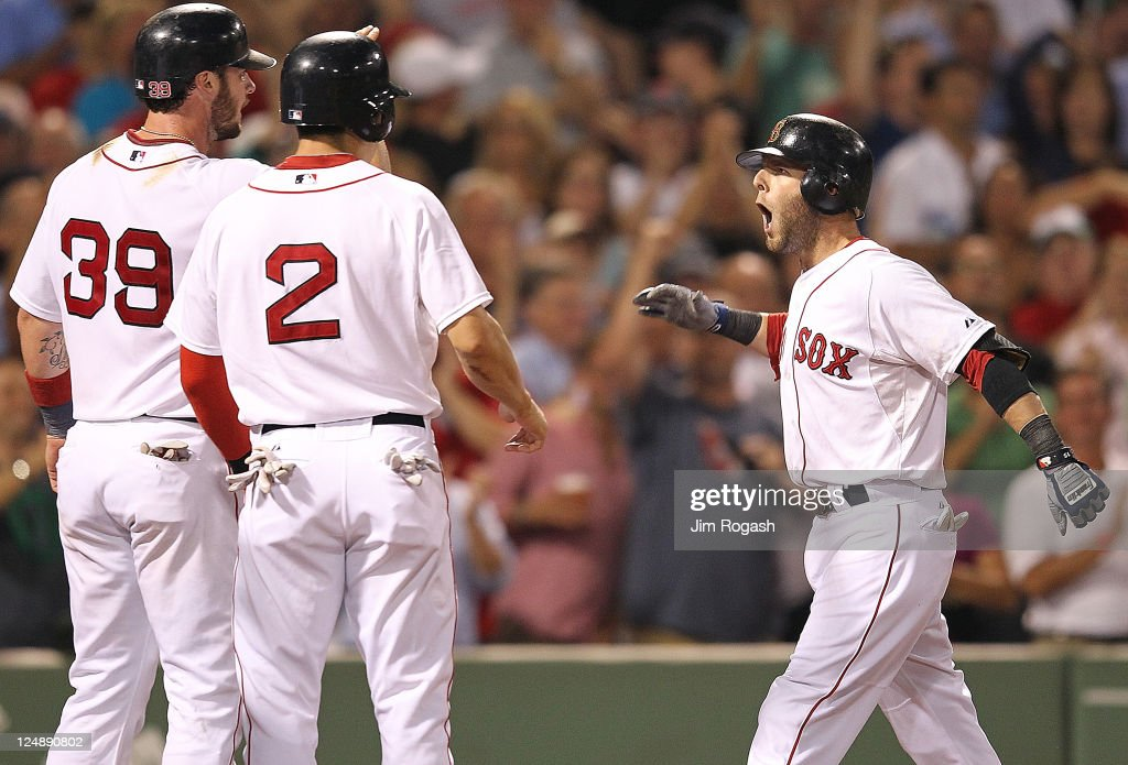 <a gi-track='captionPersonalityLinkClicked' href=/galleries/search?phrase=Dustin+Pedroia&family=editorial&specificpeople=836339 ng-click='$event.stopPropagation()'>Dustin Pedroia</a> #15 of the Boston Red Sox reacts after he hit a three-run home run with teammates <a gi-track='captionPersonalityLinkClicked' href=/galleries/search?phrase=Jarrod+Saltalamacchia&family=editorial&specificpeople=836404 ng-click='$event.stopPropagation()'>Jarrod Saltalamacchia</a> #39 of the Boston Red Sox and <a gi-track='captionPersonalityLinkClicked' href=/galleries/search?phrase=Jacoby+Ellsbury&family=editorial&specificpeople=4172583 ng-click='$event.stopPropagation()'>Jacoby Ellsbury</a> #2 of the Boston Red Sox, who were on base, in the sixth inning at Fenway Park September 13, 2011 in Boston, Massachusetts.