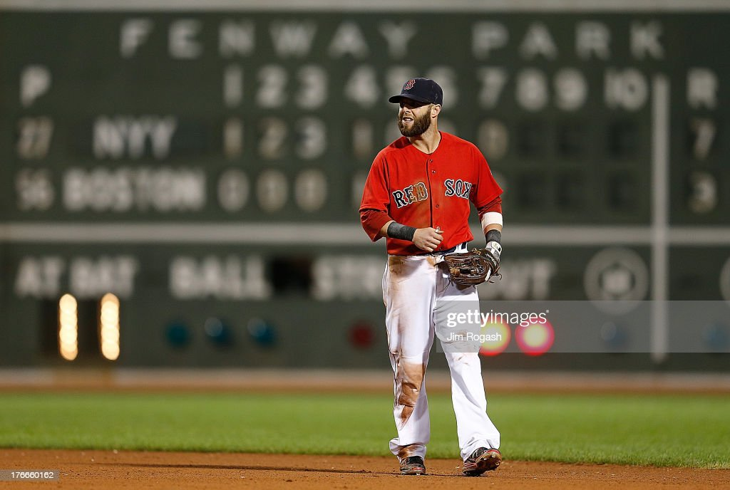 <a gi-track='captionPersonalityLinkClicked' href=/galleries/search?phrase=Dustin+Pedroia&family=editorial&specificpeople=836339 ng-click='$event.stopPropagation()'>Dustin Pedroia</a> #15 of the Boston Red Sox reacts after missed play a ball hit by Brett Gardner #11 of the New York Yankees in the 8th inning at Fenway Park on August 16, 2013 in Boston, Massachusetts.