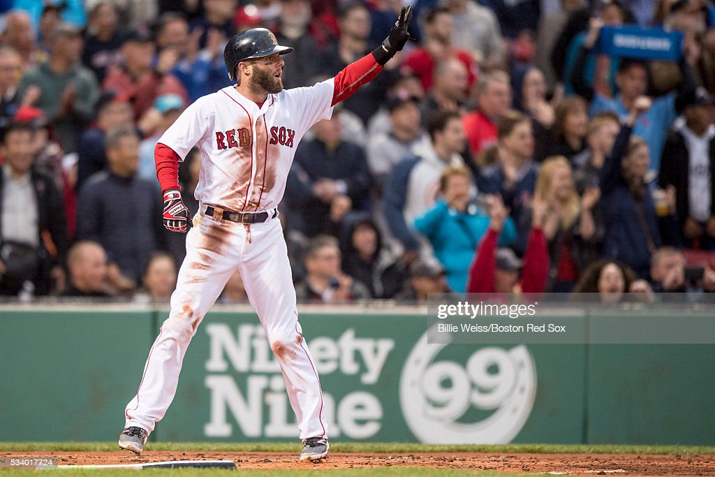 Dustin Pedroia #15 of the Boston Red Sox reacts after scoring during the first inning of a game against the Colorado Rockies on May 24, 2016 at Fenway Park in Boston, Massachusetts.