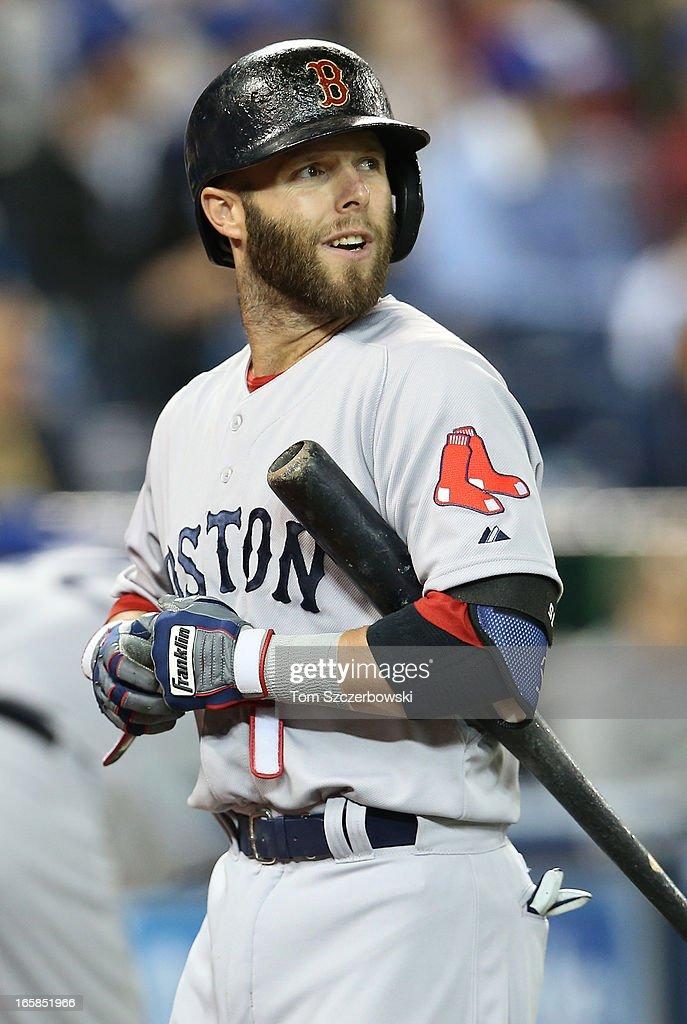 Dustin Pedroia #15 of the Boston Red Sox reacts after striking out in the first inning during MLB game action against the Toronto Blue Jays on April 6, 2013 at Rogers Centre in Toronto, Ontario, Canada.