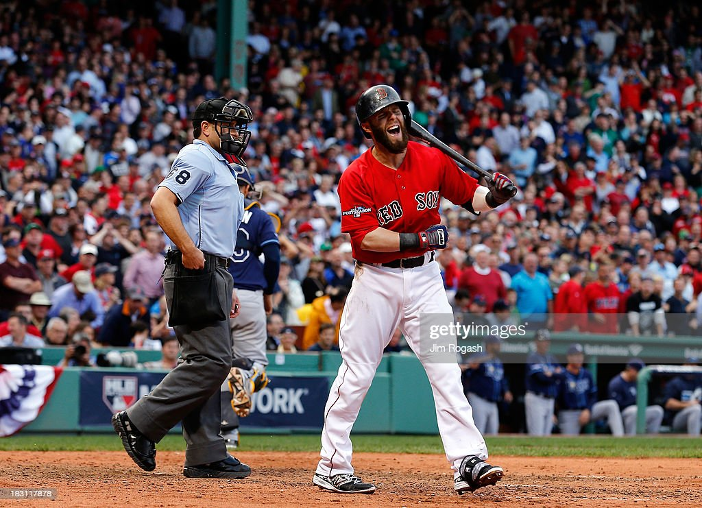 Dustin Pedroia #15 of the Boston Red Sox reacts after striking out against the Tampa Bay Rays during Game One of the American League Division Series at Fenway Park on October 4, 2013 in Boston, Massachusetts.