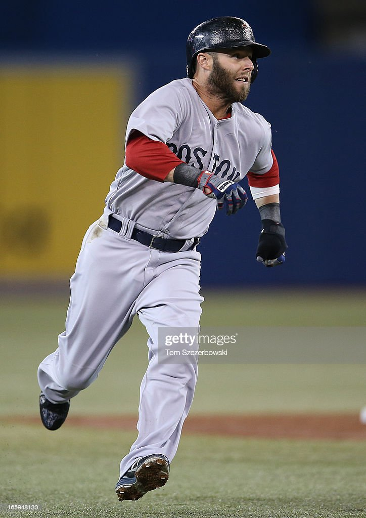 Dustin Pedroia #15 of the Boston Red Sox rounds third base to score a run in the first inning during MLB game action against the Toronto Blue Jays on April 7, 2013 at Rogers Centre in Toronto, Ontario, Canada.