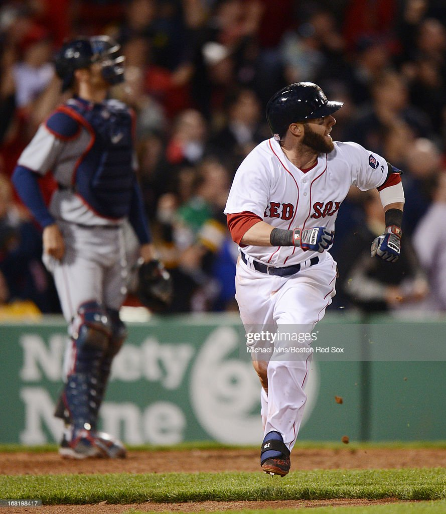 Dustin Pedroia #15 of the Boston Red Sox runs after hitting a home run against the Minnesota Twins in the eighth inning on May 6, 2013 at Fenway Park in Boston, Massachusetts.