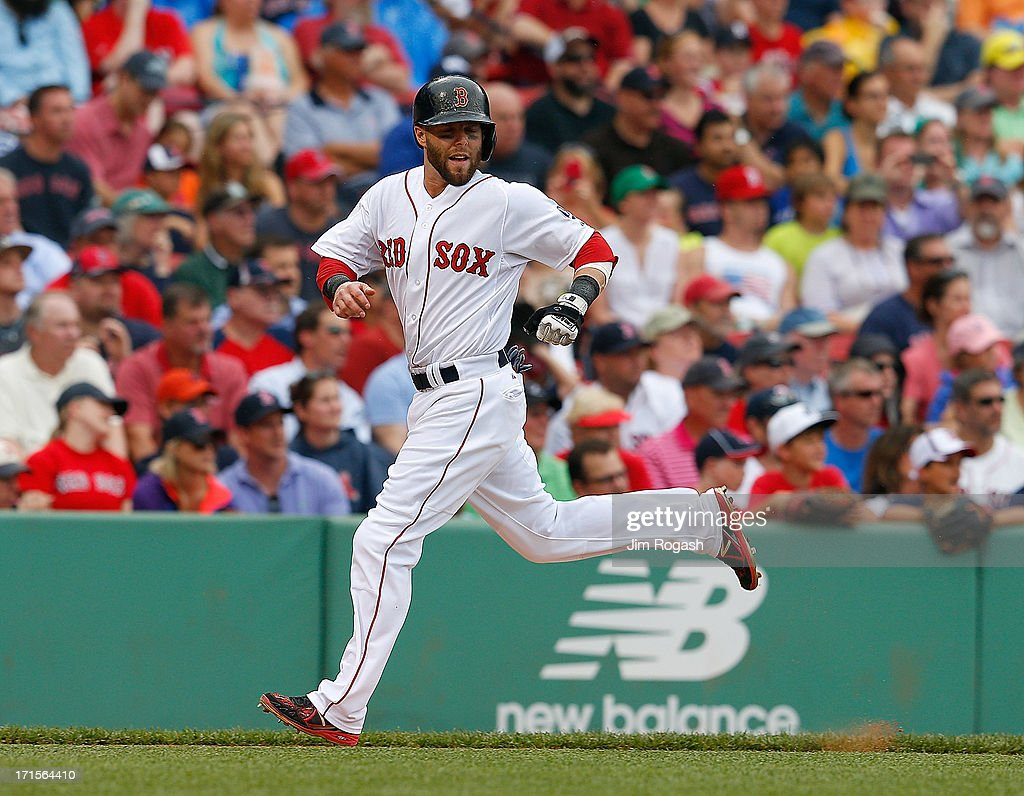 Dustin Pedroia #15 of the Boston Red Sox scores a run against the Colorado Rockies in the 3rd inning at Fenway Park on June 26, 2013 in Boston, Massachusetts.