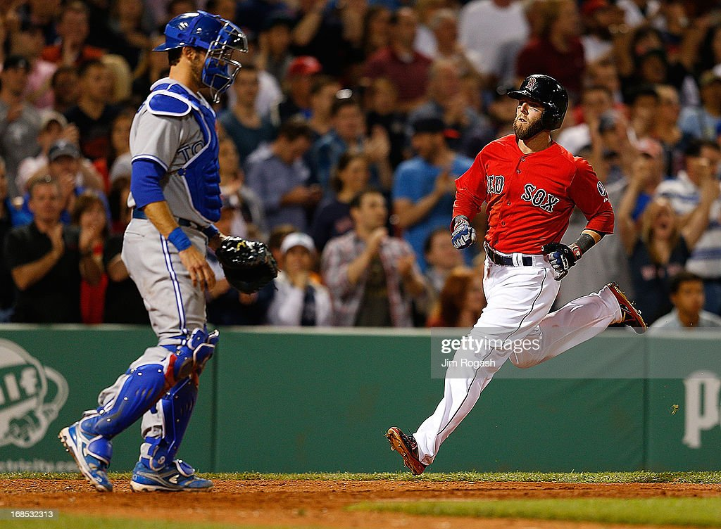 <a gi-track='captionPersonalityLinkClicked' href=/galleries/search?phrase=Dustin+Pedroia&family=editorial&specificpeople=836339 ng-click='$event.stopPropagation()'>Dustin Pedroia</a> #15 of the Boston Red Sox scores by Toronto Blue Jays in the 7th inning at Fenway Park on May 10, 2013 in Boston, Massachusetts.