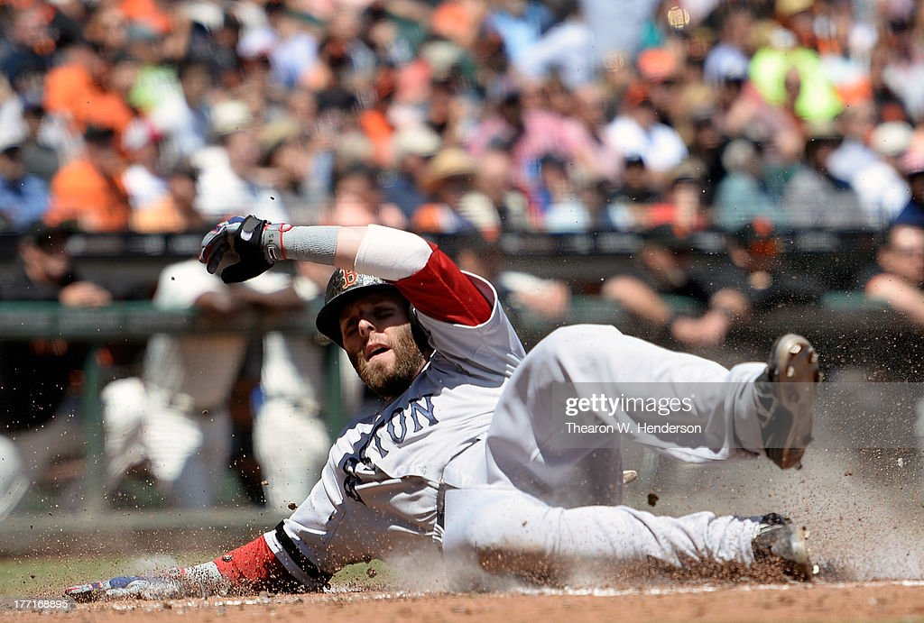 <a gi-track='captionPersonalityLinkClicked' href=/galleries/search?phrase=Dustin+Pedroia&family=editorial&specificpeople=836339 ng-click='$event.stopPropagation()'>Dustin Pedroia</a> #15 of the Boston Red Sox scores on a two-run RBI single by Jonny Gomes #5 in the third inning against the San Francisco Giants at AT&T Park on August 21, 2013 in San Francisco, California.