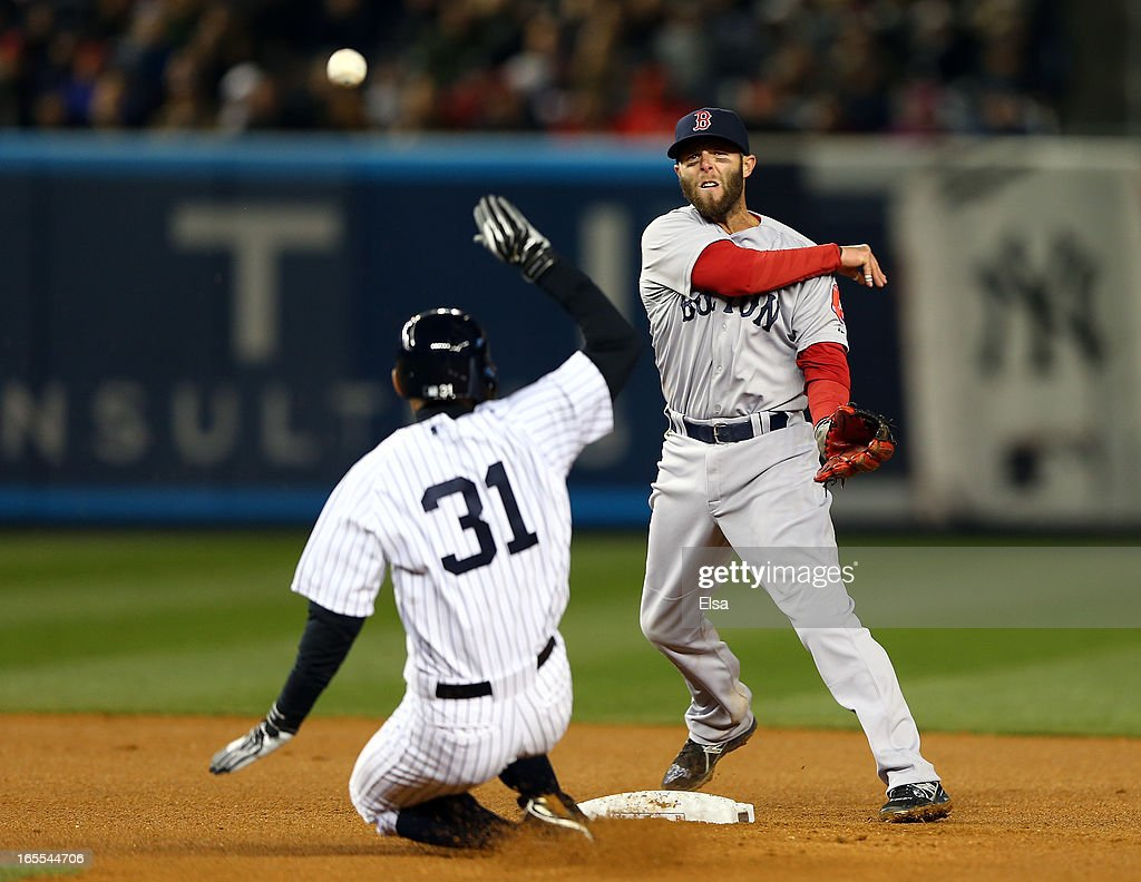 Dustin Pedroia #15 of the Boston Red Sox sends the ball to first as Ichiro Suzuki #31 of the New York Yankees is out on April 4, 2013 at Yankee Stadium in the Bronx borough of New York City.