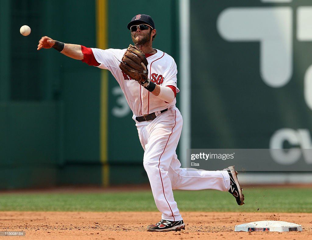 <a gi-track='captionPersonalityLinkClicked' href=/galleries/search?phrase=Dustin+Pedroia&family=editorial&specificpeople=836339 ng-click='$event.stopPropagation()'>Dustin Pedroia</a> #15 of the Boston Red Sox sends the ball to first for the out against the Chicago White Sox on June 1, 2011 at Fenway Park in Boston, Massachusetts.