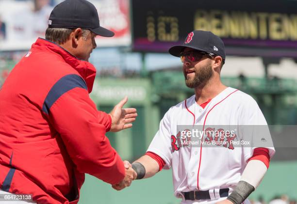Dustin Pedroia of the Boston Red Sox shakes hands with manager John Farrell during team introductions before an opening day game against the...