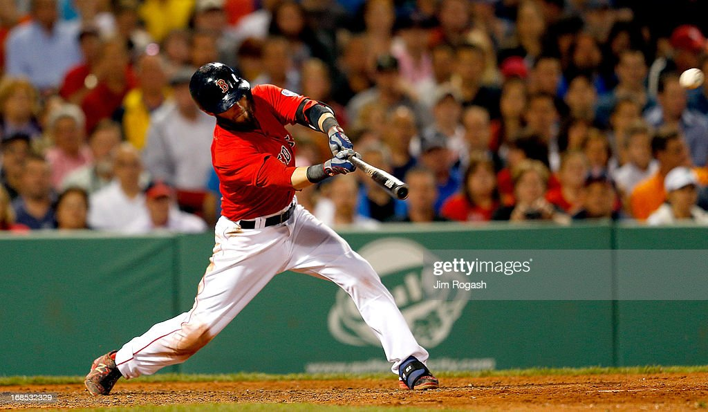 <a gi-track='captionPersonalityLinkClicked' href=/galleries/search?phrase=Dustin+Pedroia&family=editorial&specificpeople=836339 ng-click='$event.stopPropagation()'>Dustin Pedroia</a> #15 of the Boston Red Sox singles to knock in a run in the 7th inning against the Boston Red Sox at Fenway Park on May 10, 2013 in Boston, Massachusetts.
