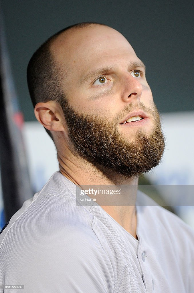 Dustin Pedroia #15 of the Boston Red Sox sits in the dugout before the game against the Baltimore Orioles at Oriole Park at Camden Yards on September 27, 2013 in Baltimore, Maryland.