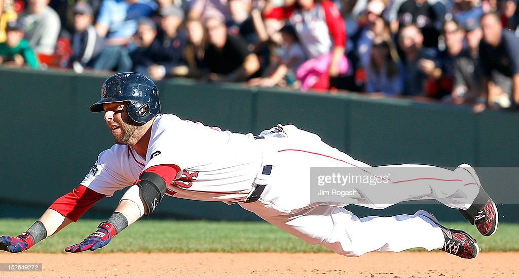 <a gi-track='captionPersonalityLinkClicked' href=/galleries/search?phrase=Dustin+Pedroia&family=editorial&specificpeople=836339 ng-click='$event.stopPropagation()'>Dustin Pedroia</a> #15 of the Boston Red Sox slides into second base on a double against the Baltimore Orioles in the eighth inning at Fenway Park on September 23, 2012 in Boston, Massachusetts.