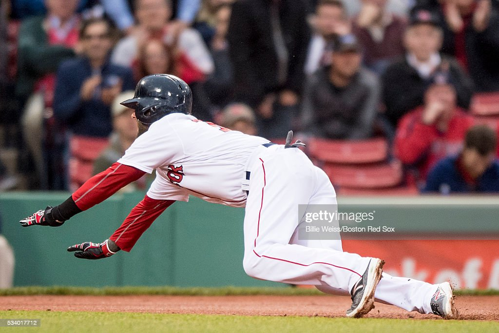 Dustin Pedroia #15 of the Boston Red Sox slides into third base during the first inning of a game against the Colorado Rockies on May 24, 2016 at Fenway Park in Boston, Massachusetts.