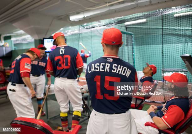 Dustin Pedroia of the Boston Red Sox stands in the batting cage with teamates wearing a jersey bearing his nickname before the start of a Player's...