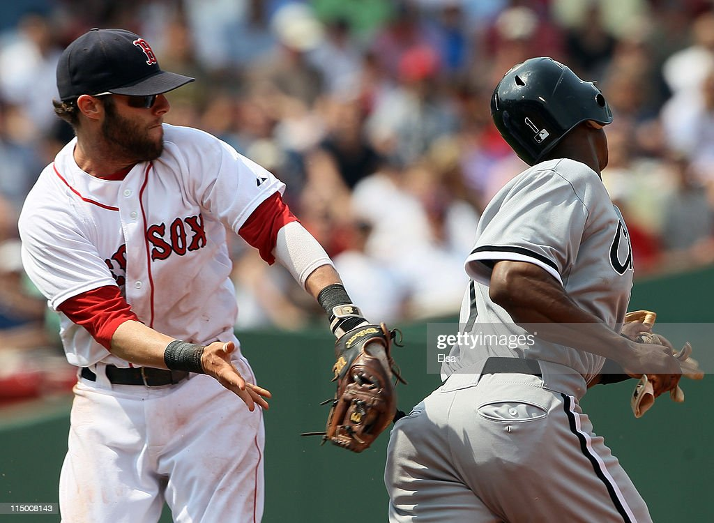 <a gi-track='captionPersonalityLinkClicked' href=/galleries/search?phrase=Dustin+Pedroia&family=editorial&specificpeople=836339 ng-click='$event.stopPropagation()'>Dustin Pedroia</a> #15 of the Boston Red Sox tags <a gi-track='captionPersonalityLinkClicked' href=/galleries/search?phrase=Juan+Pierre&family=editorial&specificpeople=202961 ng-click='$event.stopPropagation()'>Juan Pierre</a> #1 of the Chicago White Sox in a run down but the field umpire ruled Pierre to be safe at second on June 1, 2011 at Fenway Park in Boston, Massachusetts.
