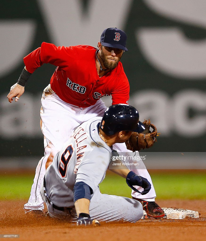 Dustin Pedroia #15 of the Boston Red Sox tags out Nick Castellanos #9 of the Detroit Tigers in the 7th inning during the game at Fenway Park on May 16, 2014 in Boston, Massachusetts.