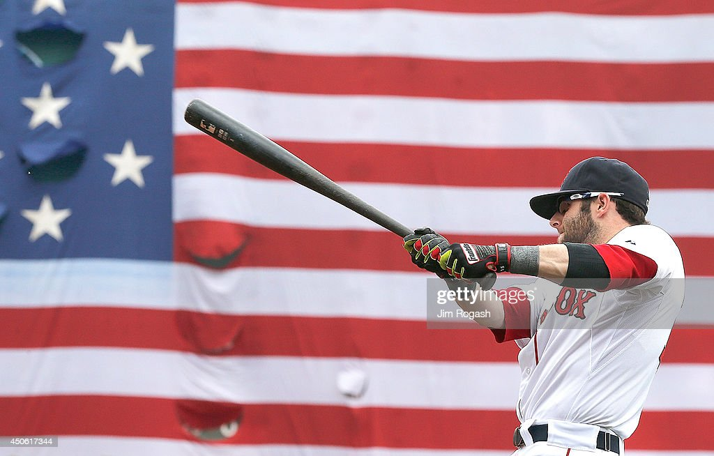 Dustin Pedroia of the Boston Red Sox takes practice swings before a game against the Cleveland Indians in the first inning at Fenway Park on June 14...