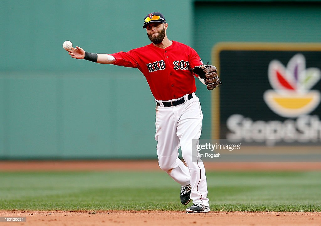 Dustin Pedroia #15 of the Boston Red Sox throws to first base against the Tampa Bay Rays during Game One of the American League Division Series at Fenway Park on October 4, 2013 in Boston, Massachusetts.