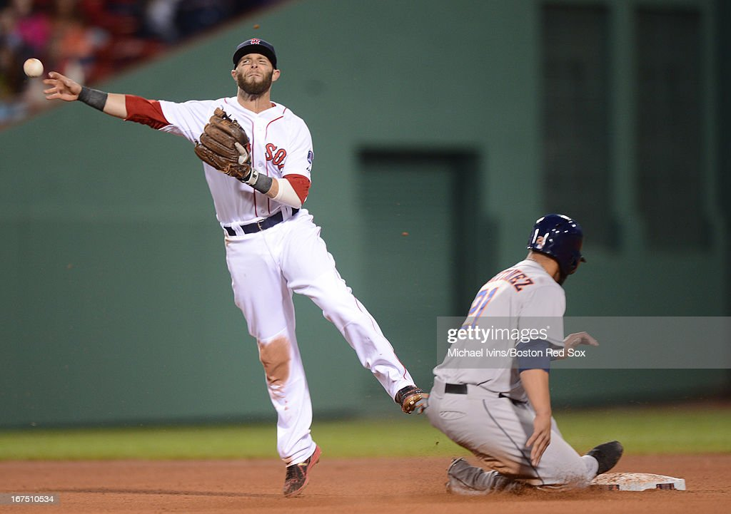 <a gi-track='captionPersonalityLinkClicked' href=/galleries/search?phrase=Dustin+Pedroia&family=editorial&specificpeople=836339 ng-click='$event.stopPropagation()'>Dustin Pedroia</a> #15 of the Boston Red Sox throws to first base for a double play over Fernando Martinez #21 of the Houston Astros in the fourth inning on April 25, 2013 at Fenway Park in Boston, Massachusetts.