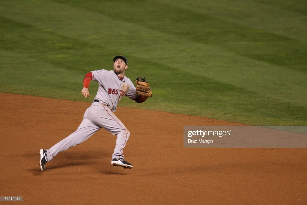 Dustin Pedroia of the Boston Red Sox tracks down ball during Game Three of the World Series against the Colorado Rockies at Coors Field in Denver, Colorado on October 27, 2007. The Red Sox defeated the Rockies 10-5.