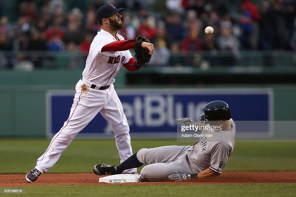 <a gi-track='captionPersonalityLinkClicked' href=/galleries/search?phrase=Dustin+Pedroia&family=editorial&specificpeople=836339 ng-click='$event.stopPropagation()'>Dustin Pedroia</a> #15 of the Boston Red Sox turns a double play over <a gi-track='captionPersonalityLinkClicked' href=/galleries/search?phrase=Brett+Gardner&family=editorial&specificpeople=4172518 ng-click='$event.stopPropagation()'>Brett Gardner</a> #11 of the New York Yankees in the first inning at Fenway Park on April 29, 2016 in Boston, Massachusetts.