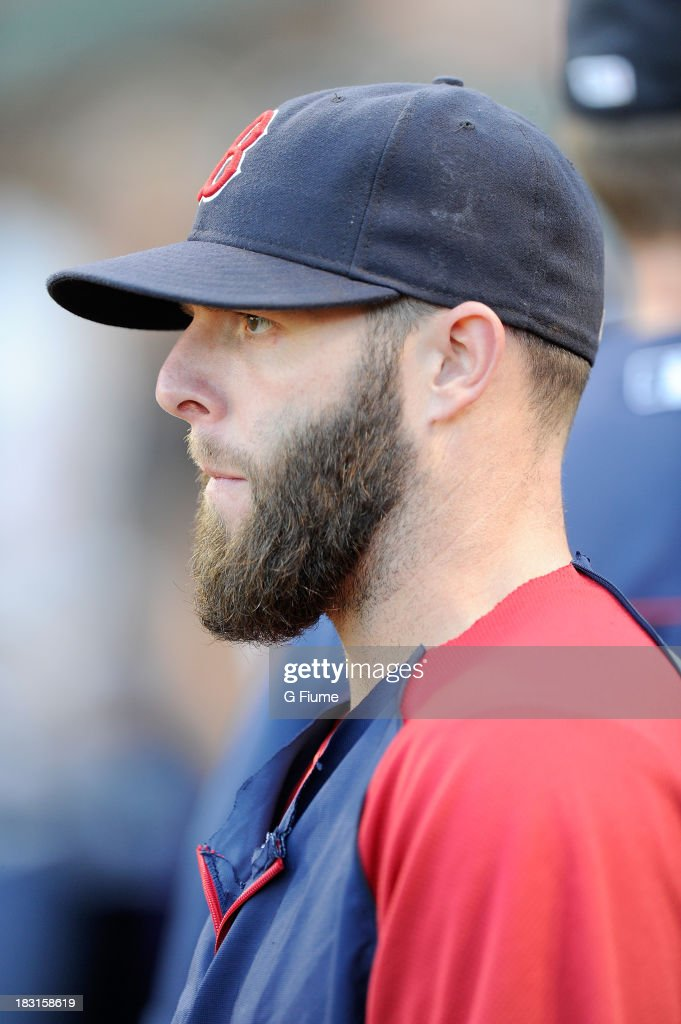 Dustin Pedroia #15 of the Boston Red Sox warms up before the game against the Baltimore Orioles at Oriole Park at Camden Yards on September 28, 2013 in Baltimore, Maryland.