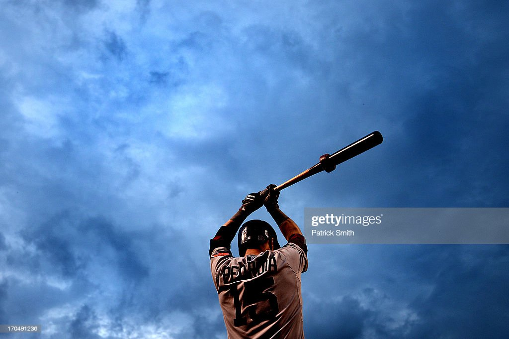 <a gi-track='captionPersonalityLinkClicked' href=/galleries/search?phrase=Dustin+Pedroia&family=editorial&specificpeople=836339 ng-click='$event.stopPropagation()'>Dustin Pedroia</a> #15 of the Boston Red Sox warms-up on deck before batting against the Baltimore Orioles in the fourth inning at Oriole Park at Camden Yards on June 13, 2013 in Baltimore, Maryland.