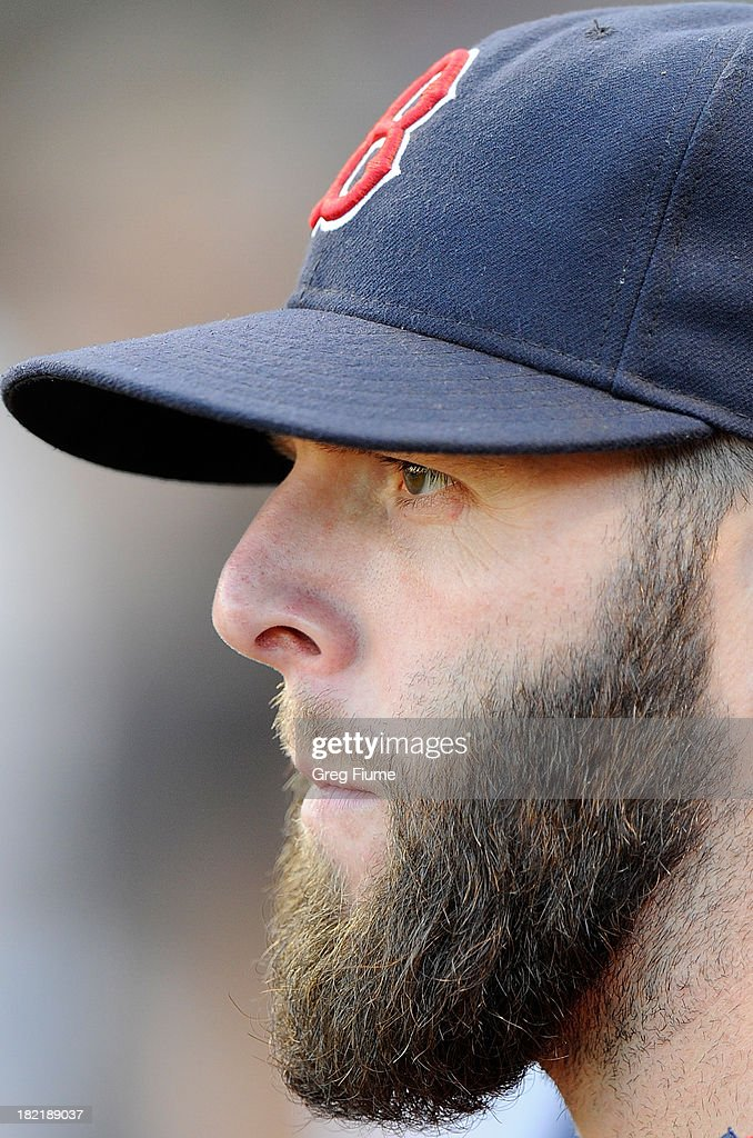 Dustin Pedroia #15 of the Boston Red Sox watches batting practice before the game against the Baltimore Orioles at Oriole Park at Camden Yards on September 28, 2013 in Baltimore, Maryland.
