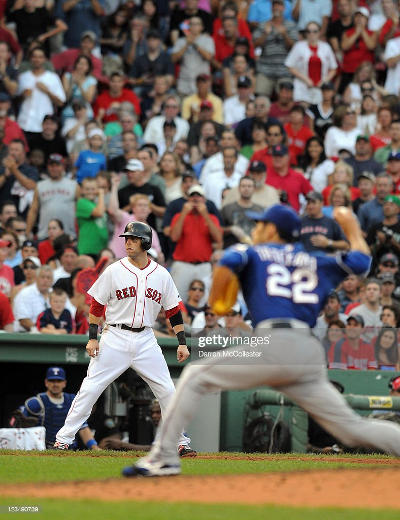 Dustin Pedroia #15 of the Boston Red Sox watches from third base as pitcher Yoshinori Tateyama #22 of the Texas Rangers throws a pitch in the fourth inning at Fenway Park on September 3, 2011 in Boston, Massachusetts.
