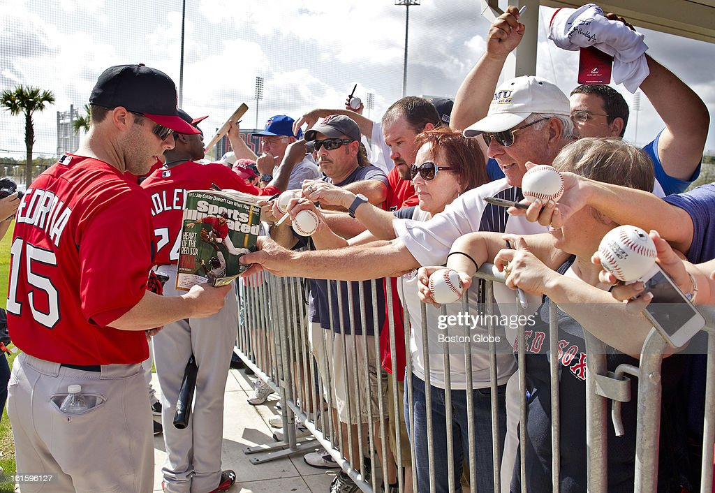 Dustin Pedroia signs autographs after the first official spring training day for the Boston Red Sox pitchers and catchers at JetBlue Park on Tuesday, Feb. 12, 2013.
