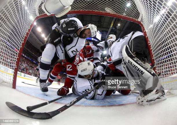 Dustin Penner Jarret Stoll Willie Mitchell and Jonathan Quick of the Los Angeles Kings fight for position against Ilya Kovalchuk and Adam Henrique of...