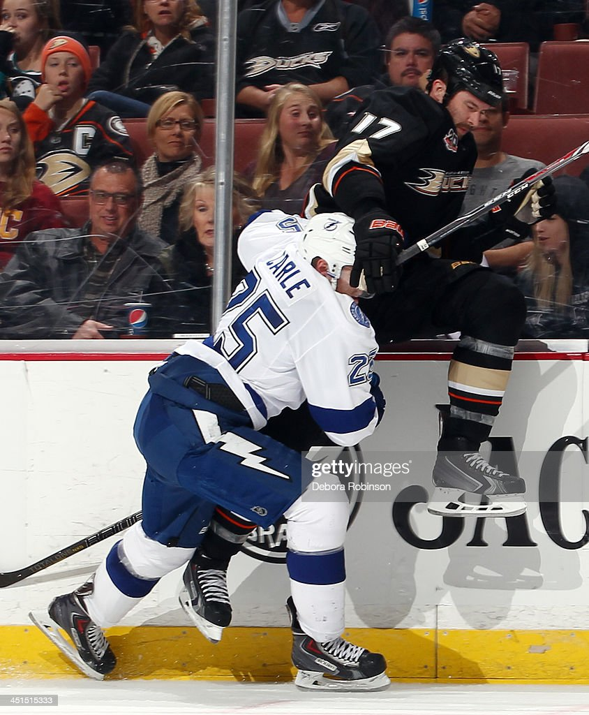 <a gi-track='captionPersonalityLinkClicked' href=/galleries/search?phrase=Dustin+Penner&family=editorial&specificpeople=589919 ng-click='$event.stopPropagation()'>Dustin Penner</a> #17 of the Anaheim Ducks collides with <a gi-track='captionPersonalityLinkClicked' href=/galleries/search?phrase=Matt+Carle&family=editorial&specificpeople=582495 ng-click='$event.stopPropagation()'>Matt Carle</a> #25 of the Tampa Bay Lightning on November 22, 2013 at Honda Center in Anaheim, California.