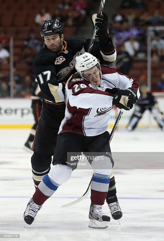 <a gi-track='captionPersonalityLinkClicked' href=/galleries/search?phrase=Dustin+Penner&family=editorial&specificpeople=589919 ng-click='$event.stopPropagation()'>Dustin Penner</a> #17 of the Anaheim Ducks hits Bryan Lerg #20 of the Colorado Avalanche in the first period at Honda Center on September 22, 2013 in Anaheim, California.