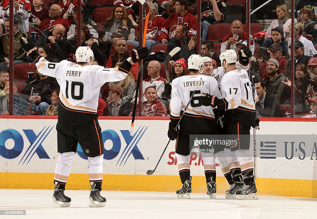 <a gi-track='captionPersonalityLinkClicked' href=/galleries/search?phrase=Dustin+Penner&family=editorial&specificpeople=589919 ng-click='$event.stopPropagation()'>Dustin Penner</a> #17 of the Anaheim Ducks is congratulated by teammates <a gi-track='captionPersonalityLinkClicked' href=/galleries/search?phrase=Ryan+Getzlaf&family=editorial&specificpeople=602655 ng-click='$event.stopPropagation()'>Ryan Getzlaf</a> #15 and <a gi-track='captionPersonalityLinkClicked' href=/galleries/search?phrase=Ben+Lovejoy&family=editorial&specificpeople=4509565 ng-click='$event.stopPropagation()'>Ben Lovejoy</a> #6 after his goal against the Phoenix Coyotes as Anaheim's <a gi-track='captionPersonalityLinkClicked' href=/galleries/search?phrase=Corey+Perry&family=editorial&specificpeople=213864 ng-click='$event.stopPropagation()'>Corey Perry</a> #10 joins the celebration during the second period at Jobing.com Arena on November 23, 2013 in Glendale, Arizona.