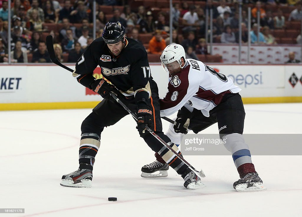 <a gi-track='captionPersonalityLinkClicked' href=/galleries/search?phrase=Dustin+Penner&family=editorial&specificpeople=589919 ng-click='$event.stopPropagation()'>Dustin Penner</a> #17 of the Anaheim Ducks is pursued by <a gi-track='captionPersonalityLinkClicked' href=/galleries/search?phrase=Jan+Hejda&family=editorial&specificpeople=624333 ng-click='$event.stopPropagation()'>Jan Hejda</a> #8 of the Colorado Avalanche for the puck in the first period at Honda Center on September 22, 2013 in Anaheim, California. The Avalanche defeated the Ducks 2-1.