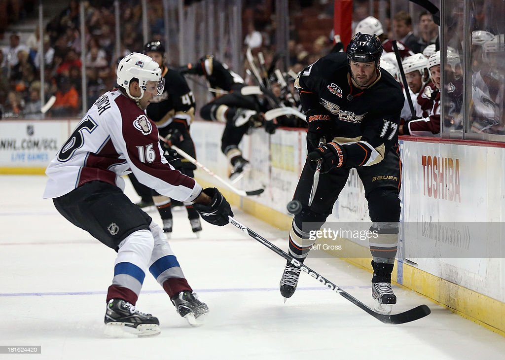 <a gi-track='captionPersonalityLinkClicked' href=/galleries/search?phrase=Dustin+Penner&family=editorial&specificpeople=589919 ng-click='$event.stopPropagation()'>Dustin Penner</a> #17 of the Anaheim Ducks shoots the puck past <a gi-track='captionPersonalityLinkClicked' href=/galleries/search?phrase=Cory+Sarich&family=editorial&specificpeople=204153 ng-click='$event.stopPropagation()'>Cory Sarich</a> #16 of the Colorado Avalanche in the third period at Honda Center on September 22, 2013 in Anaheim, California. The Avalanche defeated the Ducks 2-1.