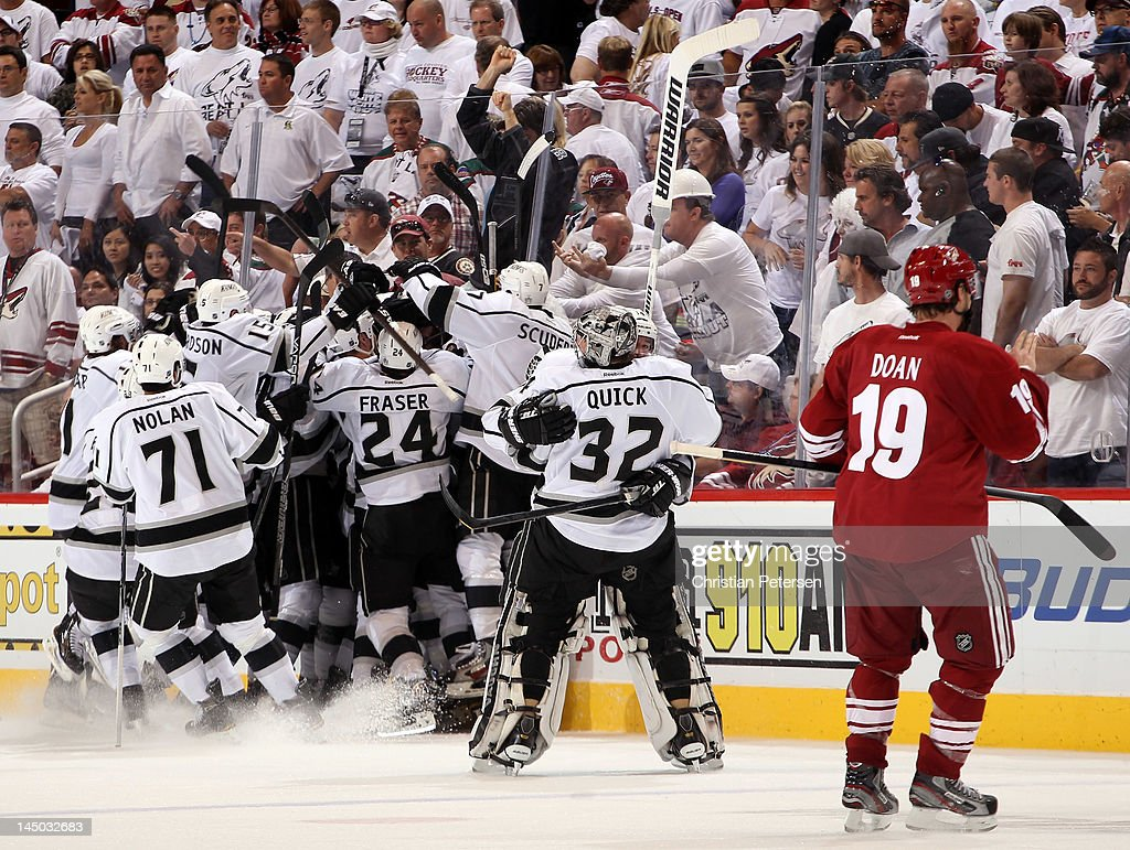 Dustin Penner of the Los Angeles Kings celebrates with teammates Slava Voynov Jeff Carter and Mike Richards after Penner scores the gamewinning goal...