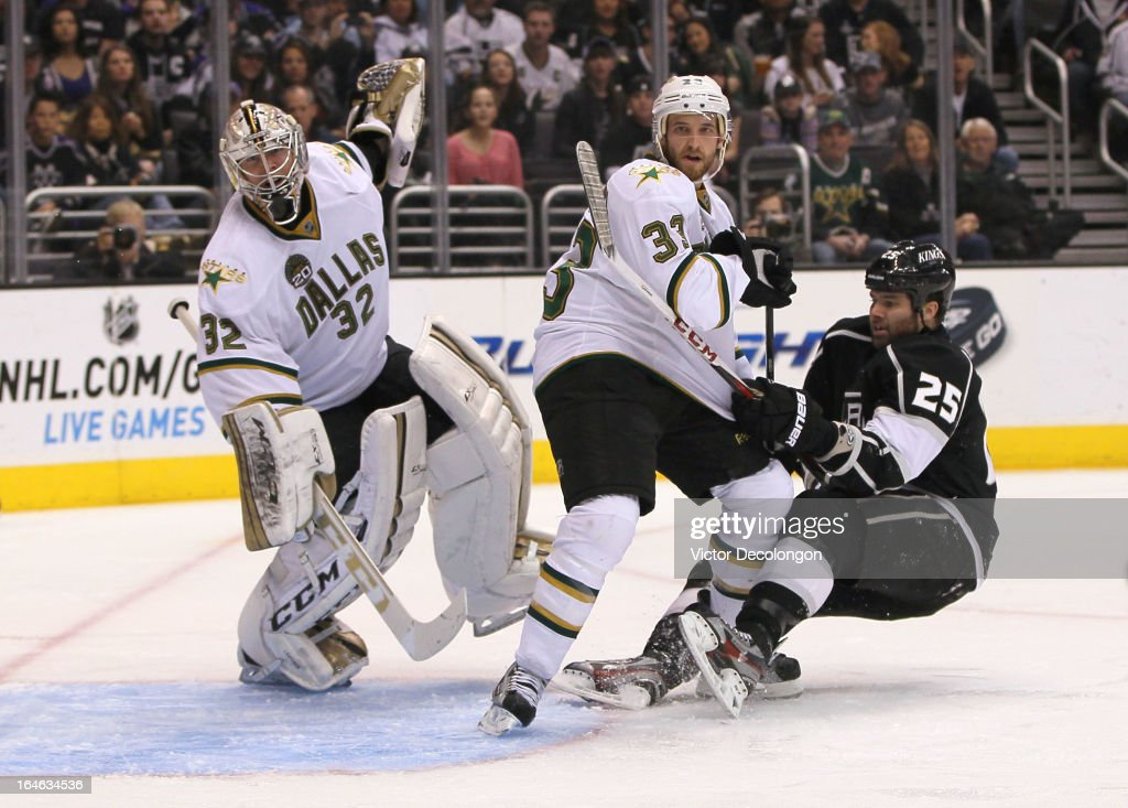 <a gi-track='captionPersonalityLinkClicked' href=/galleries/search?phrase=Dustin+Penner&family=editorial&specificpeople=589919 ng-click='$event.stopPropagation()'>Dustin Penner</a> #25 of the Los Angeles Kings falls to the ice as defenseman <a gi-track='captionPersonalityLinkClicked' href=/galleries/search?phrase=Alex+Goligoski&family=editorial&specificpeople=791866 ng-click='$event.stopPropagation()'>Alex Goligoski</a> #33 and goaltender <a gi-track='captionPersonalityLinkClicked' href=/galleries/search?phrase=Kari+Lehtonen&family=editorial&specificpeople=211612 ng-click='$event.stopPropagation()'>Kari Lehtonen</a> #32 of the Dallas Stars defend their net in the second period during the NHL game at Staples Center on March 21, 2013 in Los Angeles, California. The Stars defeated the Kings 2-0.