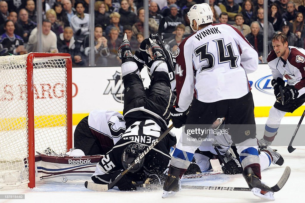 <a gi-track='captionPersonalityLinkClicked' href=/galleries/search?phrase=Dustin+Penner&family=editorial&specificpeople=589919 ng-click='$event.stopPropagation()'>Dustin Penner</a> #25 of the Los Angeles Kings flies over <a gi-track='captionPersonalityLinkClicked' href=/galleries/search?phrase=Jean-Sebastien+Giguere&family=editorial&specificpeople=202814 ng-click='$event.stopPropagation()'>Jean-Sebastien Giguere</a> #35 of the Colorado Avalanche at Staples Center on January 21, 2012 in Los Angeles, California.