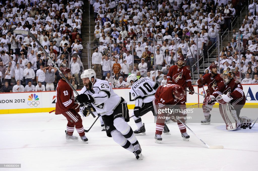 Dustin Penner #25 of the Los Angeles Kings reacts to his game winning goal against the Phoenix Coyotes in Game Five of the Western Conference Finals during the 2012 NHL Stanley Cup Playoffs at Jobing.com Arena on May 22, 2012 in Glendale, Arizona.